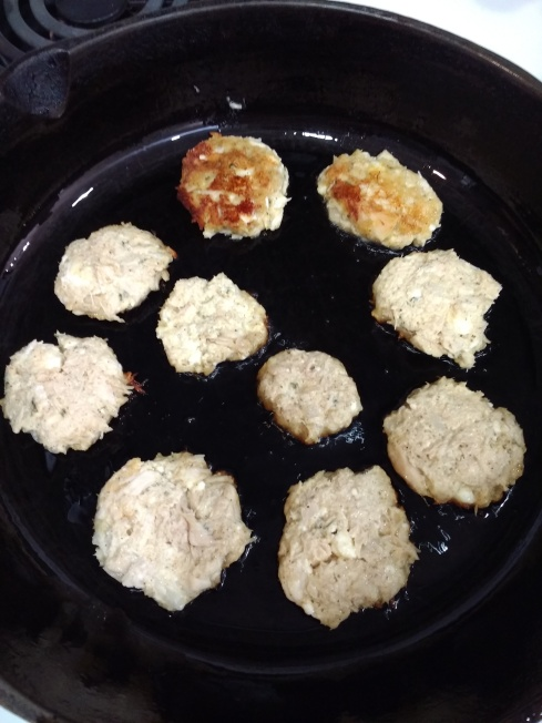 Salmon cakes in pan